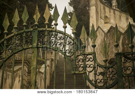 Detail of an old wrought iron gate a symbol of a bygone era and perfect craftsmanship of an earlier era.