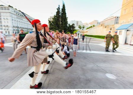 ATHENS GREECE August 172013: Greek soldiers Evzones dressed in full dress retro military uniform refers to the members of the Presidential Guard Evzones (or Evzoni) guard the Greek Tomb of the Unknown Soldier changing guard posts in front of the President