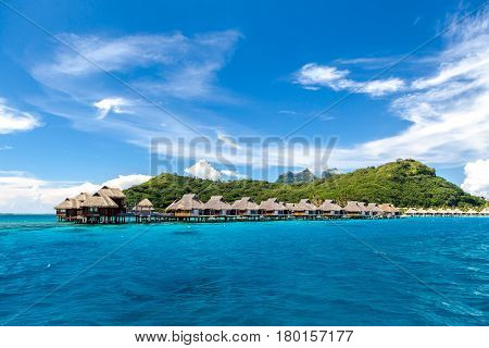 Over water bungalows on a tropical island, Bora Bora, French Polynesia