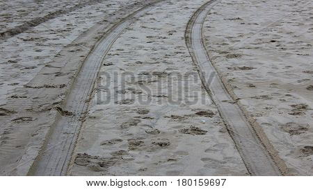 Tyre tracks in the sand at cefn sidan beach in West Wales, UK