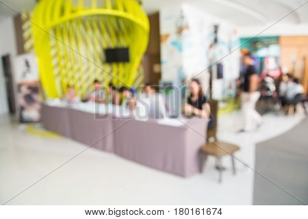 Abstract Blur Background Of Registration Desk At Business Seminar Meeting