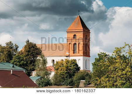 Mir, Belarus. Landscape Of Village Houses And Saint Nicolas Roman Catholic Church In Mir, Belarus. Famous Landmark.