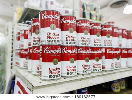 Saint Martin Dutch Antilles March 18 2017: Cans of Campbell's chicken noodle soup stand on a shelf in a supermarket.