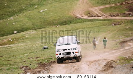 Truso Gorge, Georgia - May 22, 2016: Mitsubishi Delica Space Gear on country road in summer mountains landscape. Delica is a range of trucks and multi-purpose vehicles produced by Mitsubishi Motors.