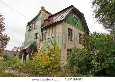Abandoned green mansion on the territory of the estate of Olgino, Ramon