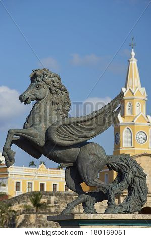 Large statues of Pegasus, the flying horse, on the road leading to the historic Clock Tower (Torre del Reloj) and main gateway into the historic walled city of Cateragena de Indias in Colombia.