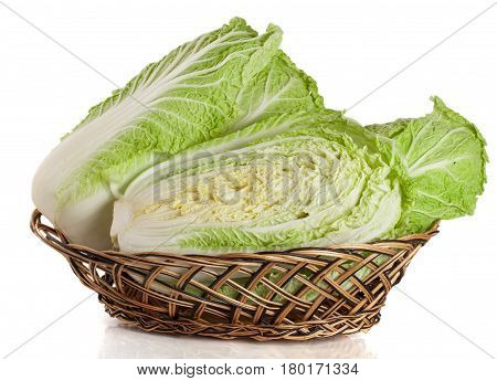 Chinese cabbage in a wicker basket isolated on white background.