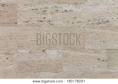 Natural Italian stone. A smooth travertine surface.