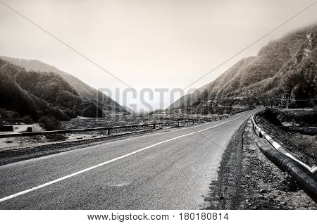 Curved Asphalt Road In High Mountains Of Ilisu, Gakh, Azerbaijan. Greyscale Landscape