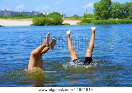 Kids Play In Water - Standing Upside Down On Hands