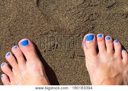 Female feet on ginger sand. Sandy beach by tropical seaside vintage background. Summer vacation in paradise banner template. Feet of woman on white sand beach toned photo. Sunny day on exotic island