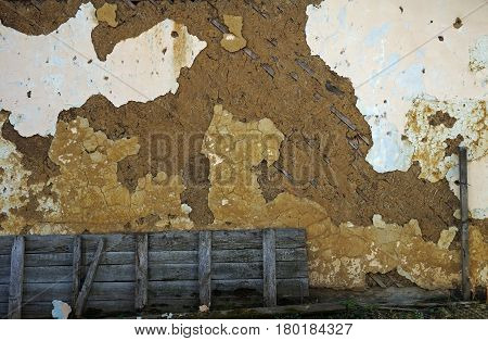 Fragment of old destroyed wall in abandoned house