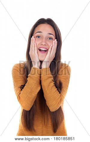 Surprised teenager girl with yellow jersey isolated on a white background