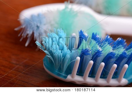 xtreme Macro close up of toothbrush with wooden background
