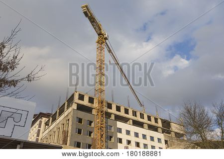 Building and Construction Concepts. Construction Building Site With Industrial Mid-Size Crane. Horizontal Image