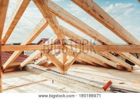 Installation Of Wooden Beams At House Construction Site. Building Details With Wood, Timber And Meta