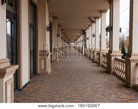 Terrace Of Residential Building In Perspective With Beautiful Lanterns On Columns