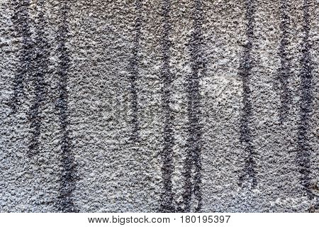 Concrete wall with traces of bitumen mastic. Abstract background