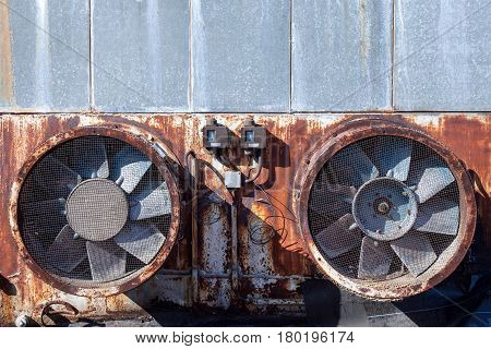 Abandoned venting fans on a chimney on an abandoned factory