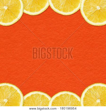 Seamless pattern of yellow lemon slices on Red Background