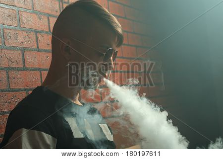 Vape. Young Handsome White Guy Lets Rings Out Of Steam. Vaping.