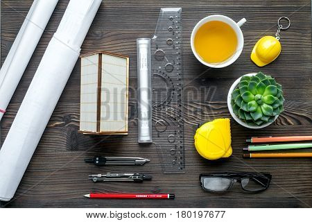 profession concept with architect desk and constructor tools on wooden background top view