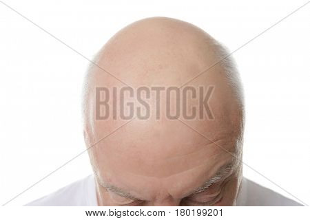 Bald senior man on white background, closeup
