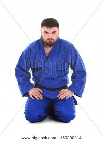 Young sporty man in kimono on white background