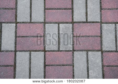 Cobbles Of Red And Gray Bricks. Stacking In Two Pieces In Different Directions.