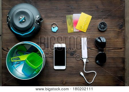 Traveler's accessories, power bank and credit cards in vacation concept on wooden table background top view