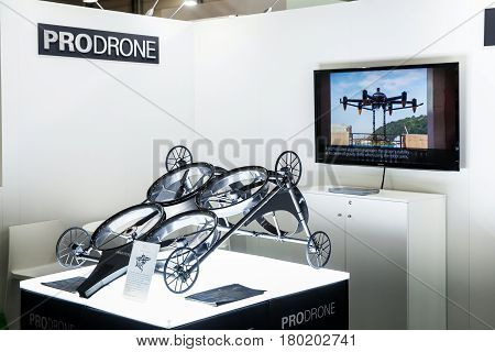 Hannover, Germany - March, 2017: Prodrone company with dual robot arm large drone participating in exhibition fair Cebit 2017 in Hannover Messe, Germany