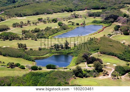 Aerial view of a golf course, Saipan, Northern Mariana Islands Pools of water accentuate the beautiful landscape of a golf course in Saipan.