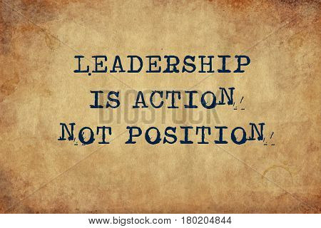 Inspiring motivation quote with typewriter text Leadership is action not position. Distressed Old Paper with Typing image.