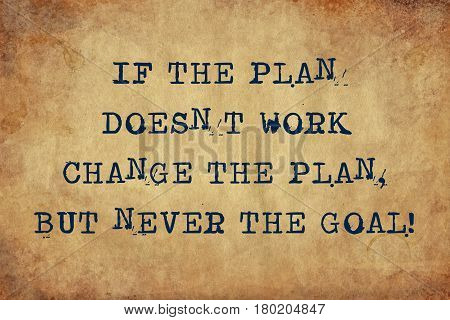 Inspiring motivation quote with typewriter text If the plan doesn't work change the plan, but never the goal. Distressed Old Paper with Typing image.