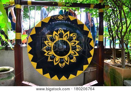 The gong on wood in temple and market