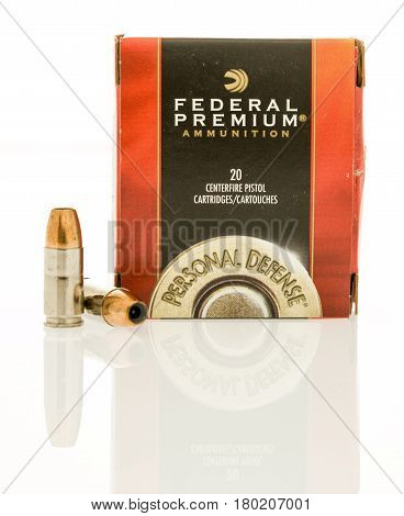 Winneconne WI - 31 March 2017: Box of Federal ammunition personal defense hollow point in 9mm an isolated background.