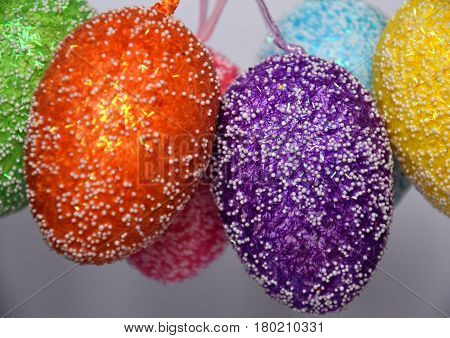Bunch of colourful panted plastic easter eggs with white dots. Easter (Paschal) eggs are decorated eggs that are usually used as gifts on the occasion of Easter or springtime celebration.