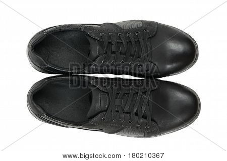 Top view of modern sport shoes isolated on white background. Men's shoes for sports.