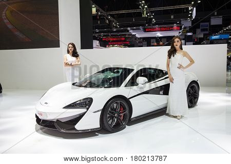 Bangkok Thailand. 28th Mar 2017. Mclaren 570s with unidentified model on display at The 38th Bangkok International Thailand Motor Show 2017 on March 28 2017 Nonthaburi Thailand