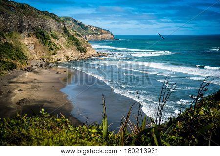 Beautiful rugged coastline with waves crashing