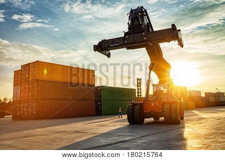 Thailand Laem Chabang Chonburi Industrial logistic forklift truck containers shipping cargo in port at sunset time.