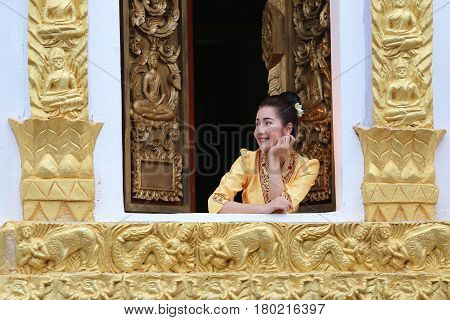 Beautiful laos woman on the Buddhist church Smiling she happiness in luang prabang laos