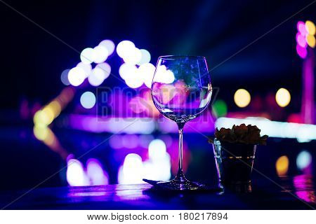 Empty wine glasses on the table at a party in one night stand.