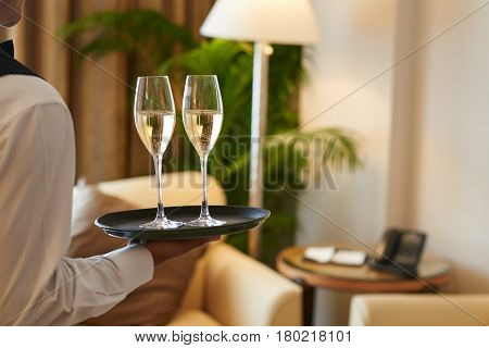 Waiter bringing drinks to the hotel room