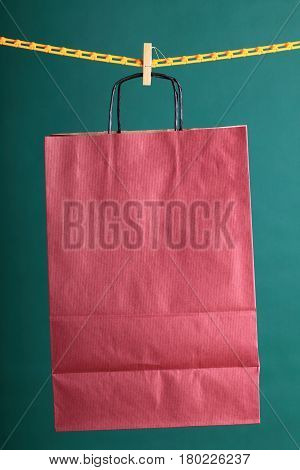 paper Shopping gift bags on green background ecologocal