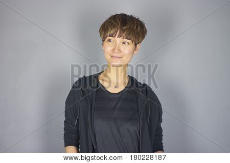 portrait of Chinese woman in leisure wear in studio