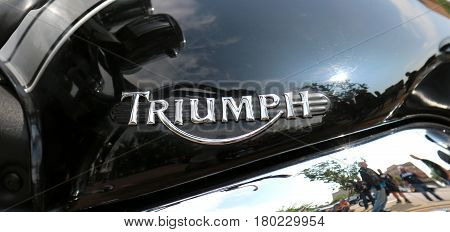 Badge Of Triumph Motorcycle At Yearly Mass Ride