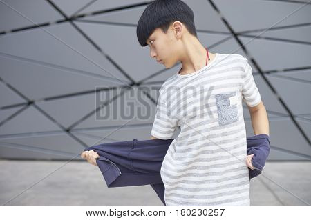 Portrait Of Cool Asian Kid Posing Outdoors