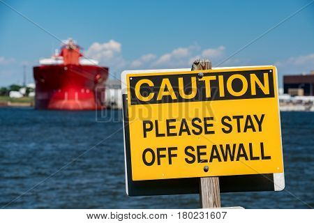 Caution Stay Out Of Seawall Sign