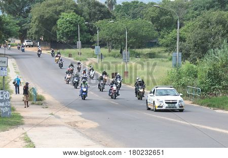 Traffic Police Car Guiding Motorbikes Through City Streets